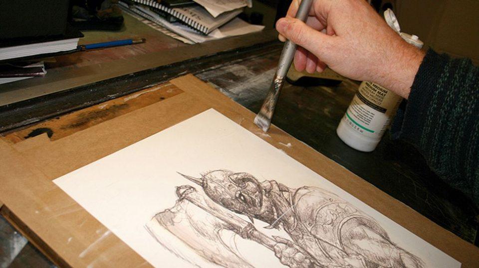 A man drawing a image